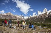 Tourists Admiring Scenic View Of Mount Fitz Roy in Patagonia.