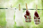 Vintage photo of baby clothes hanging on the clothesline.