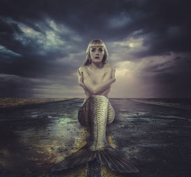 foto of fairy tail  - naked mermaid sitting on a deserted road - JPG