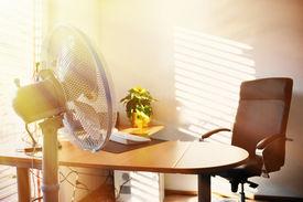 stock photo of louvers  - Fan in the office - JPG