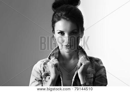 confident model holding denim collar