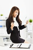 Beautiful Young Business Woman Working With Tablet In Office
