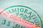 image of deportation  - closeup fragment of immigration departed stamp scanned by laser beam - JPG
