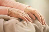 Elderly woman's hands, care for the elderly concept