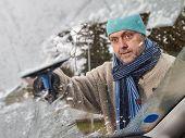 Male And Ice Scraper
