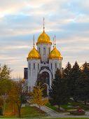 Church in the autumn park on a cloudy, overcast