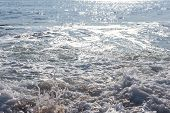 splash of seawater with sea foam and waves