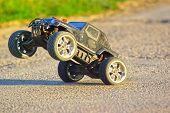 image of bigfoot  - Radio controlled car on two wheels close image - JPG