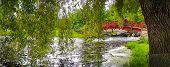 Red footbridge in the park.