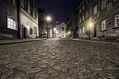 foto of tenement  - The street of the old town in Warsaw at night - JPG