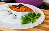Soft rice noodle with hot and spicy red curry, chicken