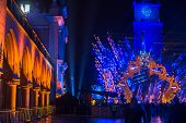 KRAKOW, POLAND - DEC 31, 2014: Historical Town Hall on the Main Market Square in Krakow during the celebration of the inhabitants of the New Year.