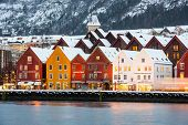 Bergen, Norway - December 29, 2014: Famous Bryggen street with wooden colored houses in Bergen at Christmas, Norway