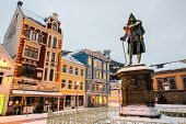 Bergen, Norway - December 29, 2014: Vagsallmenningen Square and memorial to born in 1684 Ludvig Holberg writer in city Bergen at Christmas, Norway