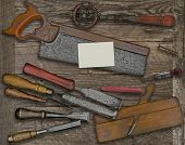 vintage woodworking  tools over wooden bench, blank business card for your text