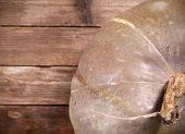 Pumpkin on aged wooden background