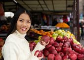 Beautiful Asian Woman Smiling Holding Apples In Hand