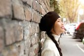 Happy Young Woman Standing Outside With Beret