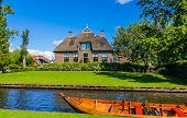tourist boat and house by canal at Giethoorn