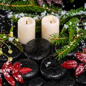 Winter Spa Concept Of Red Leaves With Drops, Snow, Evergreen Branches And Candles On Zen Stones, Clo