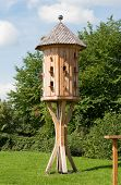 image of public housing  - A large bird house on a meadow in a public park - JPG