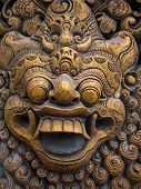 Gardian statue at the Bali temple entrance Indonesia