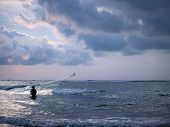 Fisherman on the beach of Kuta in Bali Indonesia