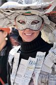 Young Woman Wearing A Newspapers Mask