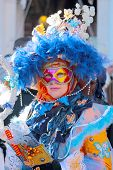 Woman Wearing A Colorful Mask During The Carnival Of Venice