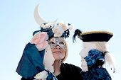 Masked Woman Playing Two Puppets During The Carnival Of Venice