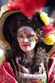 Masked Woman In Historical Dress At Carnival Of Venice