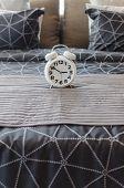 White Alarm Clock In Bedroom