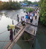 Passengers Boarding A Ferry In Sittwe, Myanmar