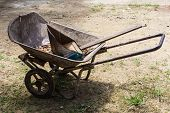 Old Wheelbarrow With Dustpan