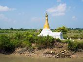 Small Pagoda Amid Rice Fields In Myanmar