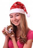 Beautiful girl in a cap with New Year tiger.