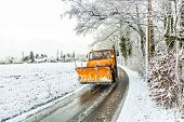 Snowplow Clears Roads Of Snow And Fallen Tree