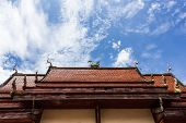 Chapel In Thai Temple Architecture Against Blue Sky