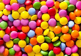 stock photo of bonbon  - color candy on a table - JPG