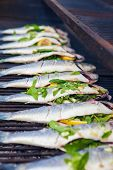 picture of bass fish  - stuffed sea bass  fish grilling on BBQ - JPG