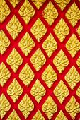 image of mural  - traditional Thai style art gold mural pattern on the red wall - JPG
