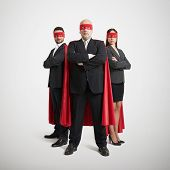 foto of cloak  - full length portrait of three superheroes in formal wear and red mask with cloak over light grey background - JPG