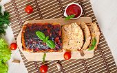 stock photo of meatloaf  - Homemade ground meatloaf with ketchup and basil - JPG