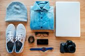 pic of no clothes  - Top view of clothing and diverse personal accessory for hipster laying on the wooden grain - JPG