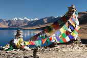 foto of jammu kashmir  - Tso Moriri Lake with prayer flags  - JPG