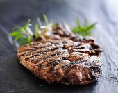 foto of slating  - grilled prime rib beef steak with rosemary on slate - JPG