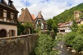 picture of landscape architecture  - Landscape of houses and river with cloudy sky in Kaysersberg - JPG