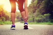 picture of ankle shoes  - woman runner hold her sports injured leg - JPG