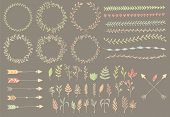 stock photo of divider  - Hand drawn vintage arrows feathers dividers and floral elements vector illustration - JPG