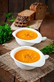 picture of lenten  - Delicious cream of pumpkin soup in a bowl on wooden table  - JPG